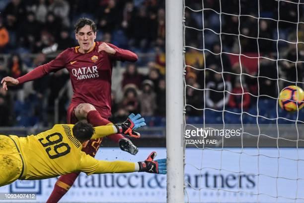 AS Roma Italian midfielder Nicolo Zaniolo shoots to score an equalizer past AC Milan's Italian goalkeeper Gianluigi Donnarumma during the Italian...