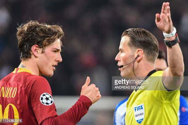AS Roma Italian midfielder Nicolo Zaniolo talks to Dutch referee Danny Makkelie after scoring during the UEFA Champions League round of 16 first leg...