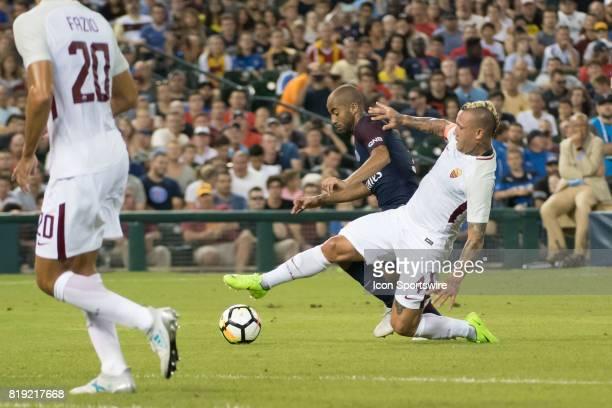 Roma M Radja Nainggolan defends Paris SaintGermain F Jesé during the International Champions Cup match between AS Roma and Paris SaintGermain on July...