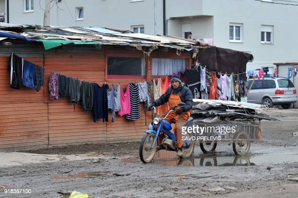 A Roma man rides a motorbike in a camp in the suburb of Konik in Podgorica on February 6 2018 It was not their war but the 1990s Kosovo conflict...