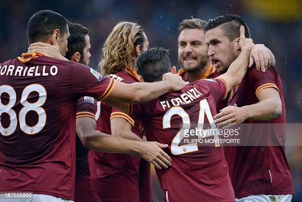 AS Roma midfielder Alessandro Florenzi celebrates with teammates after scoring against Sassuolo during their Serie A football match in Rome's Olympic...