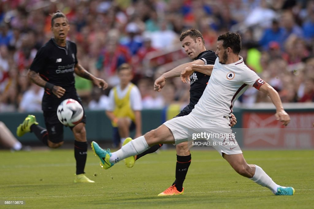 Roma midfielder Alessandro Florenzi (24) vies for the ball against Liverpool midfielder James Milner (7) during their friendly soccer match at Busch Stadium in St. Louis, Missouri on August 1, 2016. / AFP / Michael B. Thomas