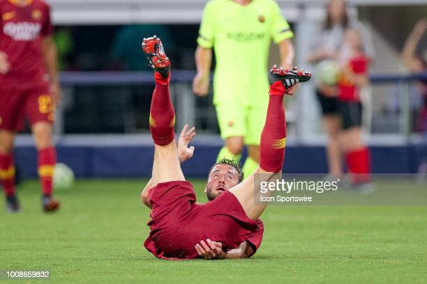 Roma midfielder Bryan Cristante rolls onto his back after scoring a goal during the International Champions Cup between FC Barcelona and AS Roma on...