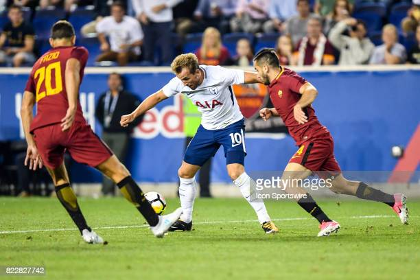 Roma midfielder Radja Nainggolan attempts to defend Tottenham Hotspur forward Harry Kane during the second half of the International Champions Cup...