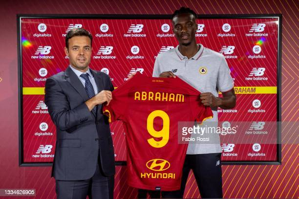 Roma new signing Tammy Abraham poses with his new jersey alonside Club's General Manager football Tiago Pinto at Centro Sportivo Fulvio Bernardini on...