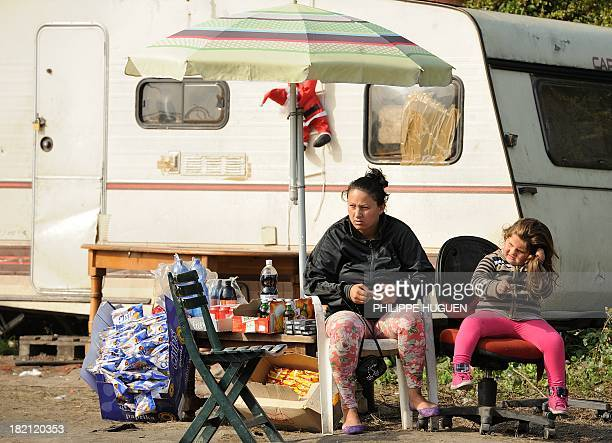 GUINE Roma people are pictured in their camp on September 28 2013 in the Northern France of Croix AFP PHOTO / PHILIPPE HUGUEN