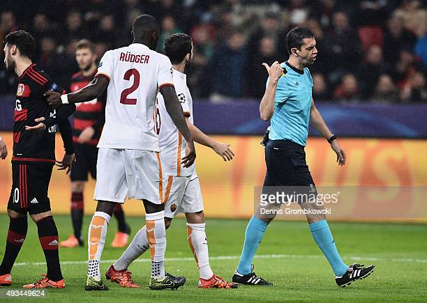 Roma players appeal to referee Viktor Kassai as he awards a penalty during the UEFA Champions League Group E match between Bayer 04 Leverkusen and AS...