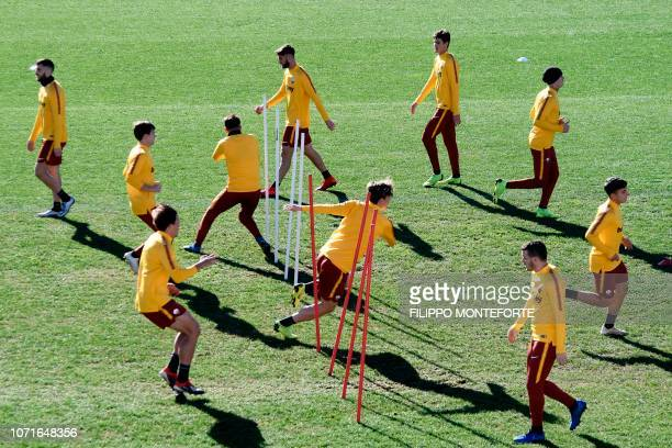 AS Roma players attend a training session on the eve of the UEFA Champions League group G football match against FC Viktoria on December 11 2018 in...
