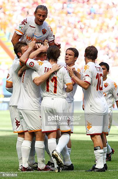Roma players celebrate a goal during the AC Milan and AS Roma Serie A match at the Stadio Giuseppe Meazza on May 24 2009 in Milan Italy