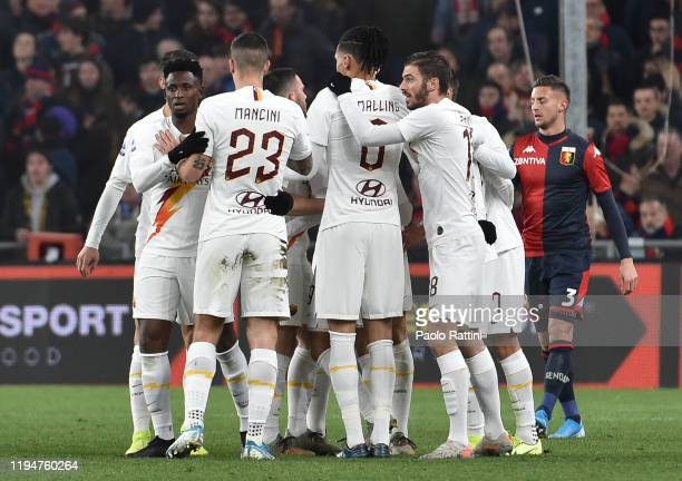 Roma players celebrate after Cengiz Under scoring the 01 goal during the Serie A match between Genoa CFC and AS Roma at Stadio Luigi Ferraris on...
