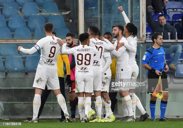 Roma players celebrate after Edin Dzeko scoring the 13 goal during the Serie A match between Genoa CFC and AS Roma at Stadio Luigi Ferraris on...