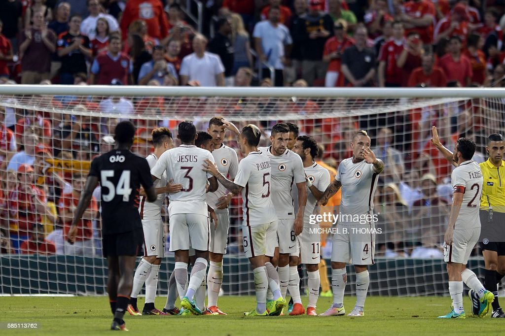Roma players celebrate after scoring a goal against Liverpool during their friendly soccer match at Busch Stadium in St. Louis, Missouri on August 1, 2016. / AFP / Michael B. Thomas