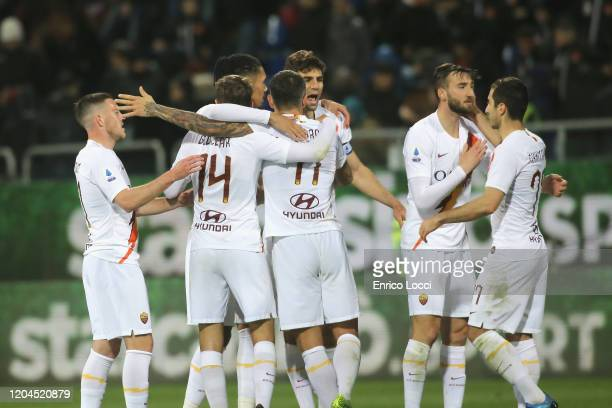 Roma players celebrate at the end of the match during the Serie A match between Cagliari Calcio and AS Roma at Sardegna Arena on March 1 2020 in...