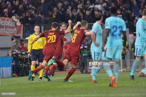 AS roma players celebrates during the UEFA Champions League quarter final match between AS Roma and FC Barcelona at the Olympic stadium on April 10...