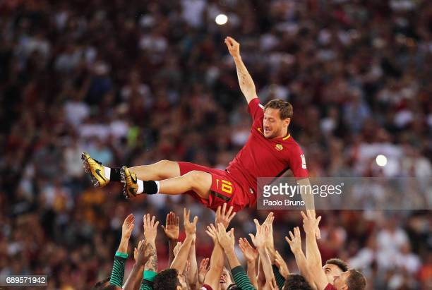 Roma players hold up Francesco Totti after his last match after the Serie A match between AS Roma and Genoa CFC at Stadio Olimpico on May 28 2017 in...