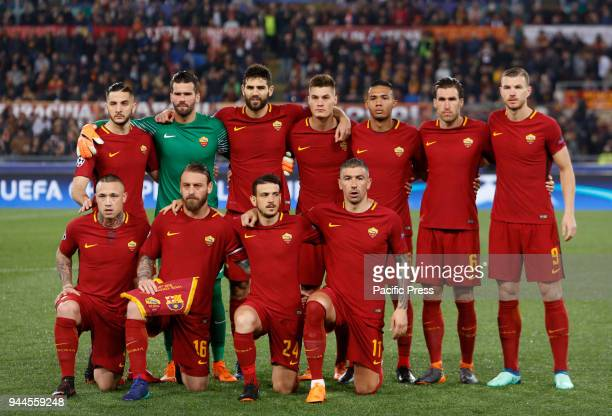 Roma players pose for photos before the start of the Champions League quarter final second leg soccer match between Roma and FC Barcelona at the...