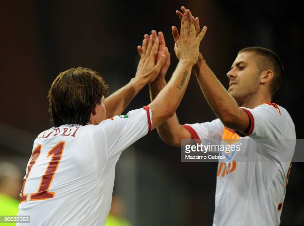 Roma players Rodrigo Ferrante Taddei and Jeremy Menez celebrate the goal scored by Rodrigo Ferrante Taddei during the Serie A match between Genoa CFC...