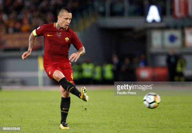 Roma Radja Nainggolan kicks the ball during the Serie A soccer match between Roma and Crotone at the Olympic stadium