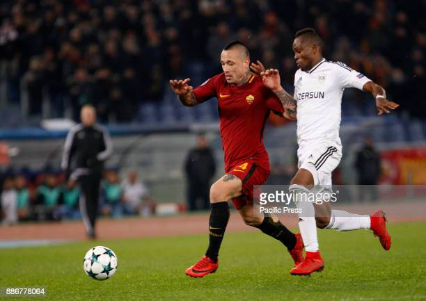 Roma Radja Nainggolan left is chased by Qarabag Donald Guerrier during the Champions League Group C soccer match between Roma and Qarabag at the...