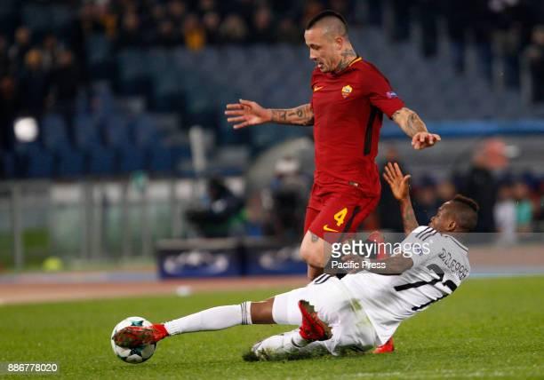 Roma Radja Nainggolan left is tackled by Qarabag Donald Guerrier during the Champions League Group C soccer match between Roma and Qarabag at the...