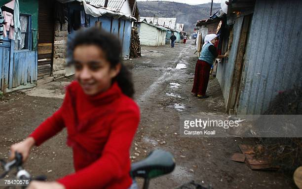 Roma refugee cleans the windows of her house in the Cesmin Lug refugee camp in the Serbian district December 12 2007 in Kosovo province Serbia One...
