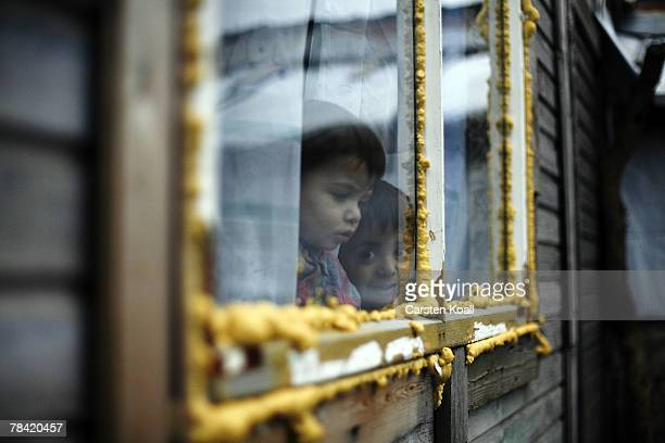 Roma refugee looks out of a window in his house in the Cesmin Lug refugee camp in the Serbian district December 12 2007 in Kosovo province Serbia One...
