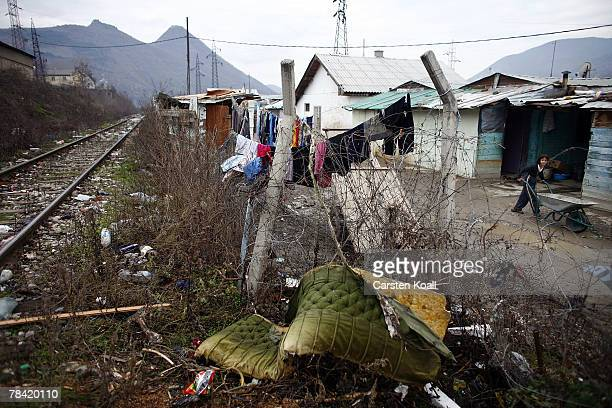 Roma refugee pushes a wheelbarrow in the Cesmin Lug refugee camp in the Serbian district December 11 2007 in Kosovo province Serbia One hundred and...