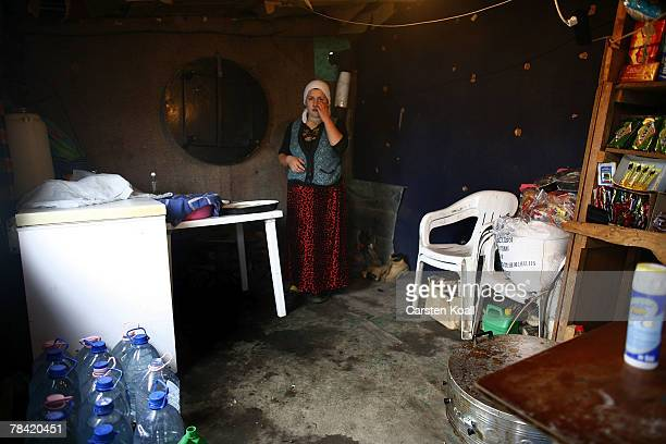 Roma refugee stands in her house in the Cesmin Lug refugee camp in the Serbian district December 12 2007 in Kosovo province Serbia One hundred and...