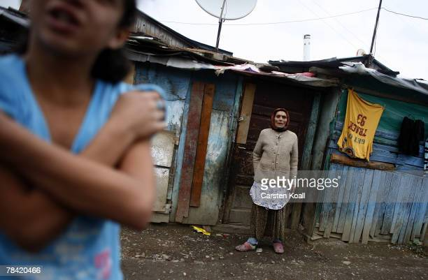 Roma refugee stands outside her house in the Cesmin Lug refugee camp in the Serbian district December 12 2007 in Kosovo province Serbia One hundred...