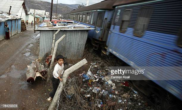 Roma refugee watches a passing train in the Cesmin Lug refugee camp in the Serbian district December 12 2007 in Kosovo province Serbia One hundred...