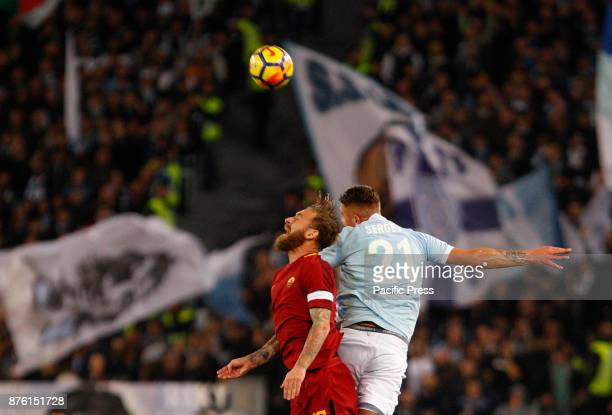 Roma s Daniele De Rossi left and Lazio s Sergej MilinkovicSavic jump for the ball during the Serie A soccer match between Roma and Lazio at the...
