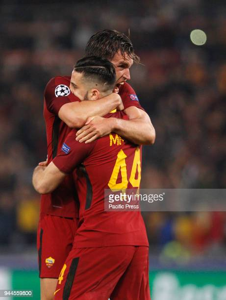 Roma s Kevin Strootman left and Kostas Manolas celebrate at the end of the Champions League quarter final second leg soccer match between Roma and FC...