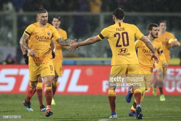 AS Roma Serbian defender Aleksandar Kolarov taps hand with AS Roma Argentine defender Federico Fazio after scoring during the Italian Tim Cup round...