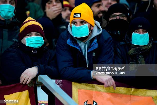 AS Roma supporters wearing protective face masks prior the UEFA Europa League round of 32 second leg football match between KAA Gent and AS Roma on...