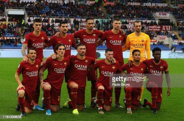 Roma team poses wiht the red mark on the face to support the campaign 'un rosso alla violenza' during the Serie A match between AS Roma and Brescia...