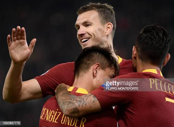 AS Roma Turkish forward Cengiz Under celebrates with AS Roma Bosnian forward Edin Dzeko and teammates after scoring during the UEFA Champions League...