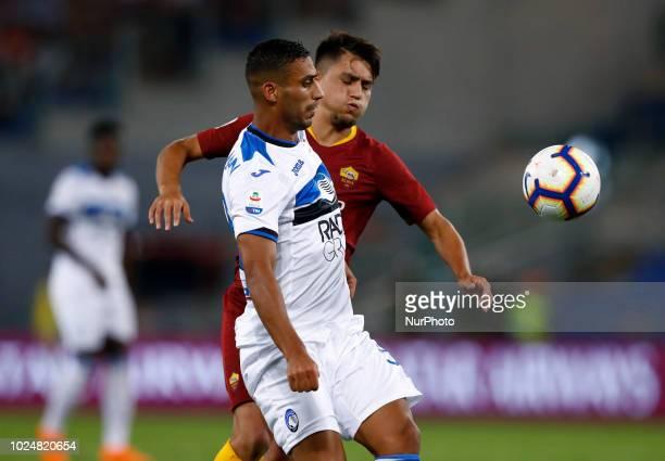 AS Roma v Atalanta BC Serie A Kadhim Ali Adnan of Atalanta and Cengiz Under of Roma at Olimpico Stadium in Rome Italy on August 27 2018