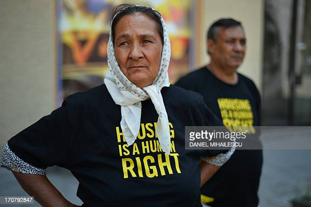Roma who are victims of forced eviction wear tshirts reading 'Housing is a human right' at the launching of the house of cards a photo exhibition...