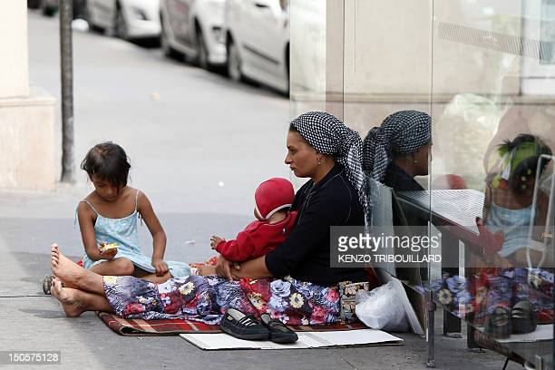 A Roma woman and her children begs place de la Bastille in Paris on August 22 2012 The French government seeks to end a row over its treatment of...