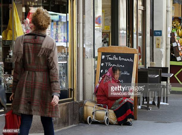 A Roma woman begs in front of a shop in a street of Paris' 6th district on April 15 2014 An internal note from the district's police authority asks...
