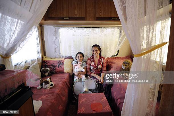 Roma woman poses with her children in her caravan on September 1 2011 at the Solidaritybased Lodging Area opened in the Belle de Mai district in the...