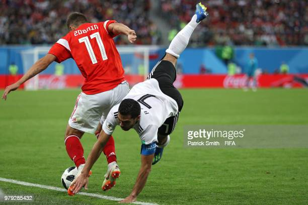 Roma Zobnin of Russia challenges Ahmed Fathi of Egypt in the second half during the 2018 FIFA World Cup Russia group A match between Russia and Egypt...