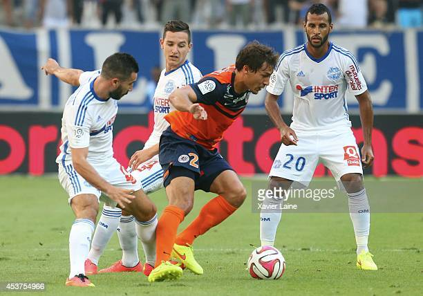 Romain Alessandrini Florian Thauvin and Jacques Romao of Olympique de Marseille FC and Benjamin Stambouli of Montpellier Herault FC during the French...