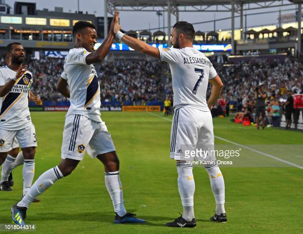 Romain Alessandrini gets a high five from Ola Kamara of Los Angeles Galaxy after a goal in the the game against the Minnesota United at StubHub...