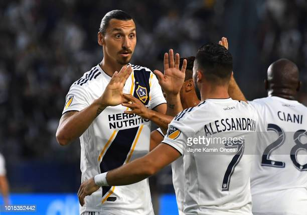 Romain Alessandrini gets a high five from Zlatan Ibrahimovic of Los Angeles Galaxy after scoring a goal in the first half of the game against the...