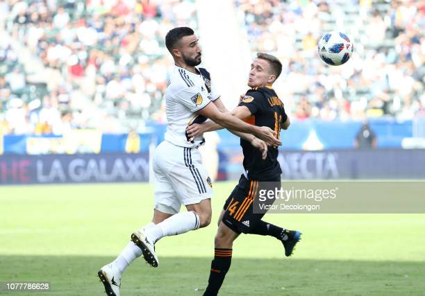 Romain Alessandrini of Los Angeles Galaxy and Adam Lundqvist of Houston Dynamo vie for the ball during the second half of their MLS match at StubHub...