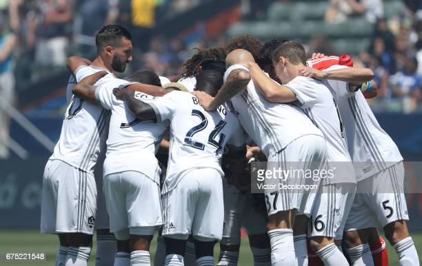 Romain Alessandrini of Los Angeles Galaxy and his teammates huddle at midfield prior to the start of their the MLS match against the Seattle Sounders...