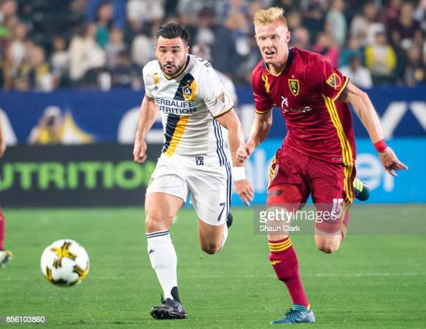 Romain Alessandrini of Los Angeles Galaxy and Justen Glad of Real Salt Lake battle for the ball during the Los Angeles Galaxy's MLS match against...