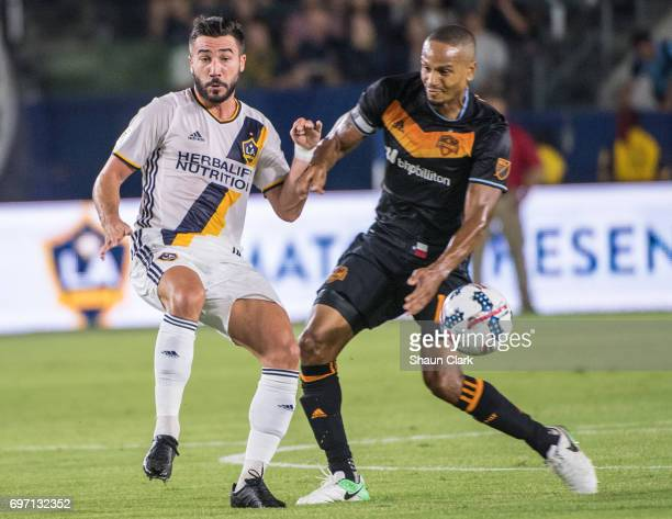 Romain Alessandrini of Los Angeles Galaxy and Ricardo Clark of Houston Dynamo during the Los Angeles Galaxy's MLS match against Houston Dynamo at the...