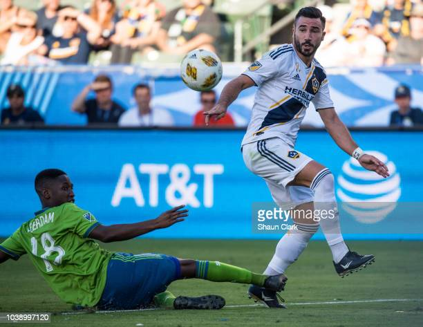 Romain Alessandrini of Los Angeles Galaxy assists on the goal by Ema Boateng of Los Angeles Galaxy as Kelvin Leerdam of Seattle Sounders defends...